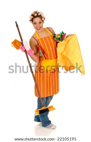 Attractive young housewife with curlers in hair and net on head, wearing colorful apron. Studio, white background