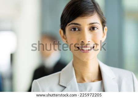 attractive young indian corporate worker in office - stock photo