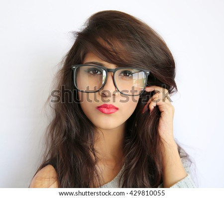 Attractive young indian girl with eye glasses, indian lady wearing spectacles on white Background - stock photo