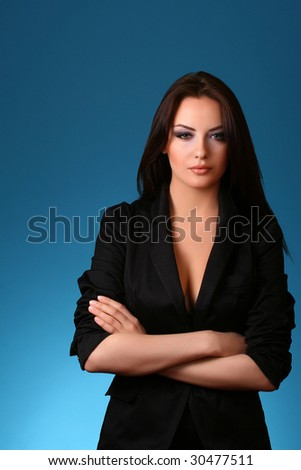 attractive young lady isolated on blue background - stock photo