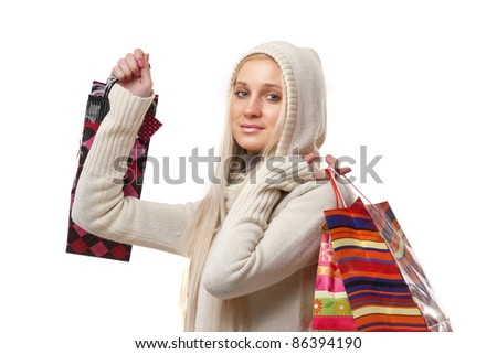 Attractive young lady out shopping. Bags with purchases. isolated on white background - stock photo
