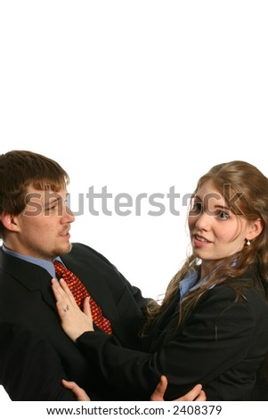 Attractive young lady refusing sexual advance - stock photo