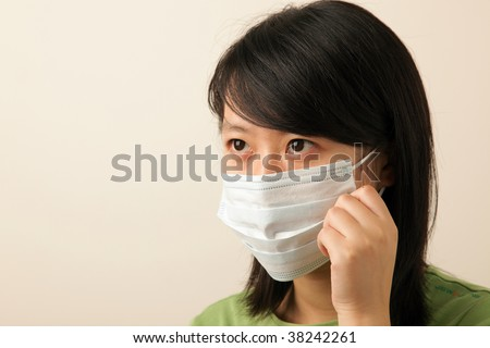attractive young lady with a face mask for flu