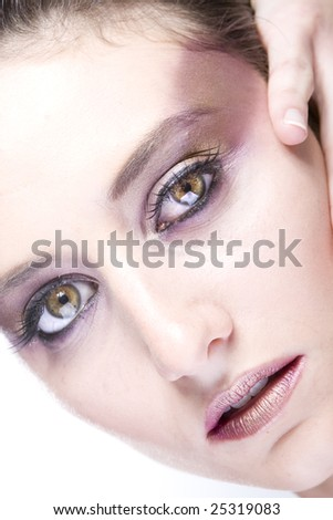 Attractive young lady with extravegant makeup and eyelashes
