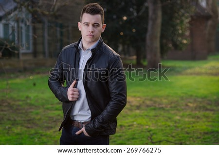Attractive young male model posing outdoors - stock photo