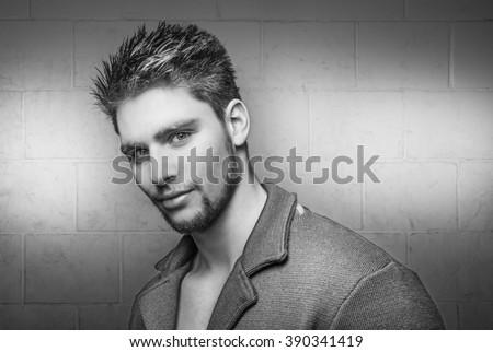 Attractive young male model wearing a jacket - Handsome male model wearing a blazer  - stock photo