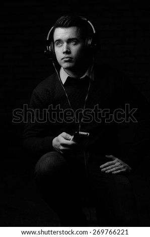 Attractive young male model with headphones - stock photo
