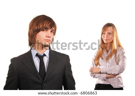 Attractive young man and girl isolated over white background. Focus on the man, girl is out of focus!