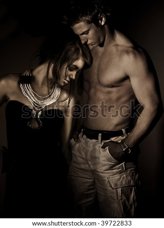attractive young man and woman couple - stock photo