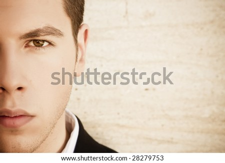 Attractive young man close portrait - stock photo