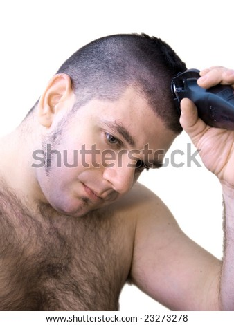Attractive young man cutting his hear - stock photo