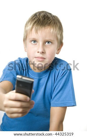Attractive young man handing cellphone forward over white background