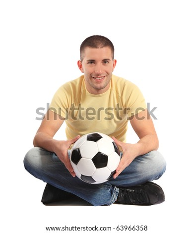 Attractive young man holding a soccer ball. All on white background - stock photo