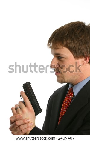 attractive young man in a suit with a handgun