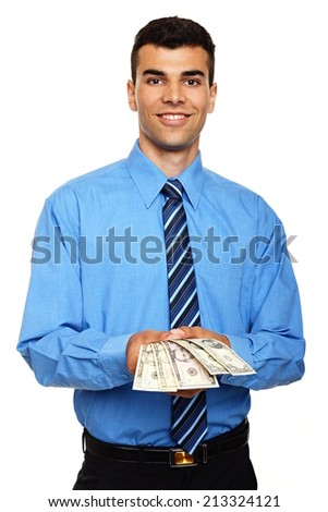 Attractive young man in blue shirt shows you money - stock photo