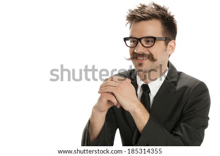 Attractive young man in business suit sits with hands folded isolated on white background - stock photo