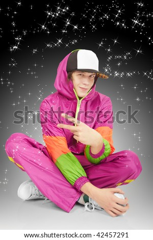 Attractive young man in color suit on the starry background - stock photo