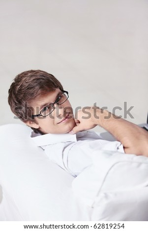 Attractive young man on the couch - stock photo