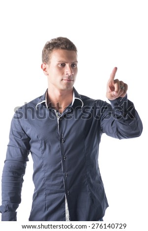 Attractive young man pressing imaginary button in the air with his finger. Isolated on white - stock photo