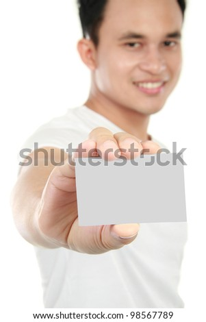 attractive young man showing blank card isolated on white background - stock photo