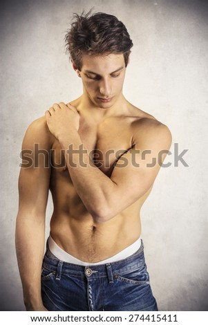 Attractive young man showing fit body - stock photo