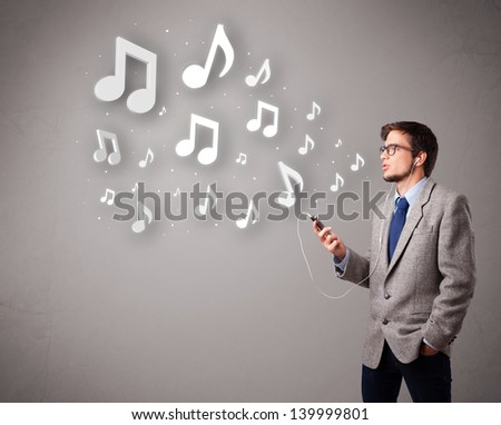 attractive young man singing and listening to music with musical notes getting out of his mouth - stock photo
