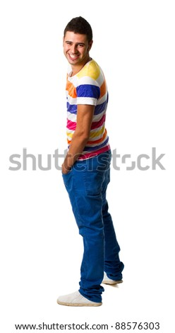 Attractive young man standing with his hands in his pockets