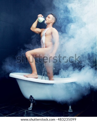 attractive young man taking a bath with milk