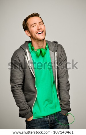 Attractive young man wearing hoodie smiling - stock photo