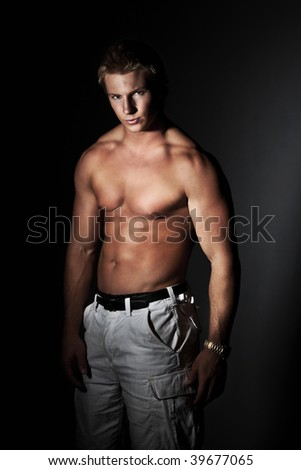 Attractive young man with a muscular body - stock photo