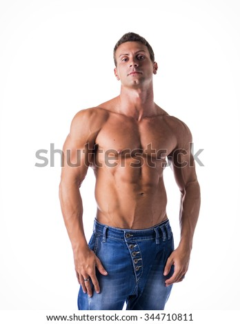 Attractive young man with naked muscular torso, wearing jeans, isolated on white background - stock photo