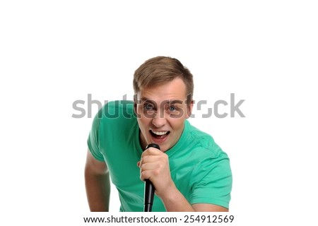 Attractive young man with positive emotions and energy is screaming into the microphone. - stock photo
