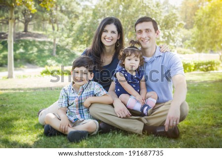 Attractive Young Mixed Race Family Outdoor Portrait in the Park. - stock photo