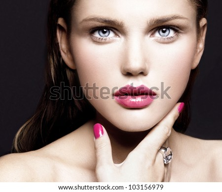 attractive young model with bright make-up and manicure - stock photo