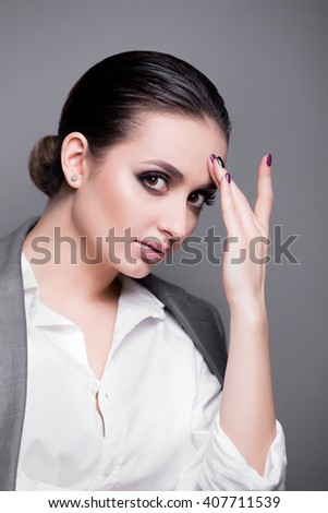 Attractive young model with bright make-up and manicure. Woman close-up portrait. Professional Make up for Brunette. Creative Hairstyle, Makeup and Nail Polish - stock photo