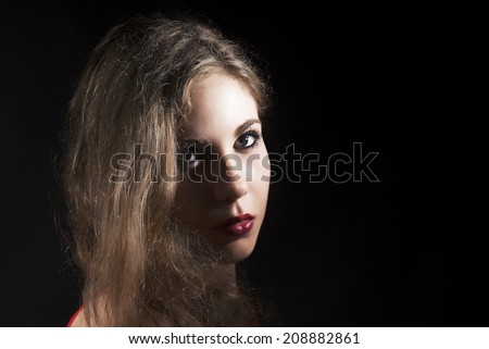Attractive Young Model With Bright Make-up On Black Background - stock photo