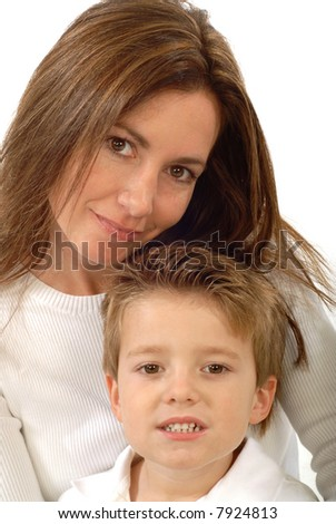 Attractive young mother holding her toddler son and smiling - stock photo