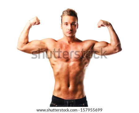 Attractive young muscular man standing naked posing, double biceps pose, isolated - stock photo