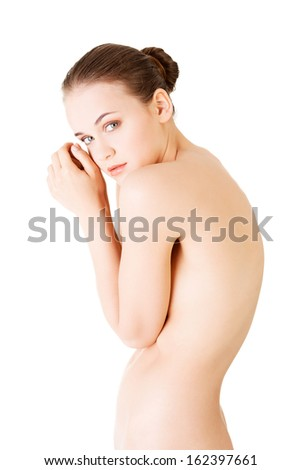 Attractive young naked woman. Side, curbed view. Isolated on white.