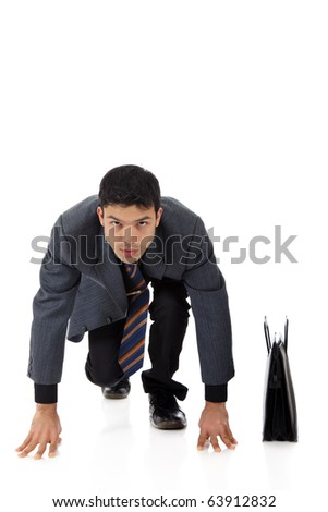 Attractive young nepalese businessman with suitcase kneeling,  ready for race. Studio shot. White background. - stock photo