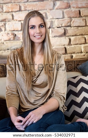 Attractive young nordic type woman smiling happy, looking at camera.