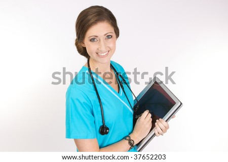 Attractive young nurse working with software on a tablet pc versus manual clipboard - stock photo