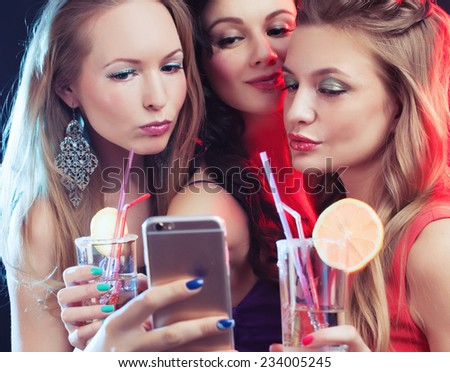 attractive young people dancing at disco and having duck face, making selfie - stock photo