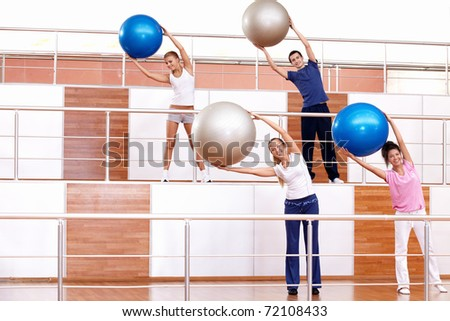 Attractive young people in the fitness club - stock photo