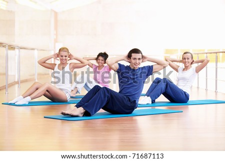 Attractive young people involved in fitness - stock photo