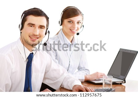 Attractive young people working in a call center isolated on white background - stock photo