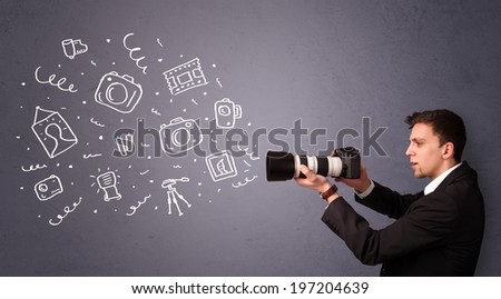Attractive young photographer shooting photography icons - stock photo