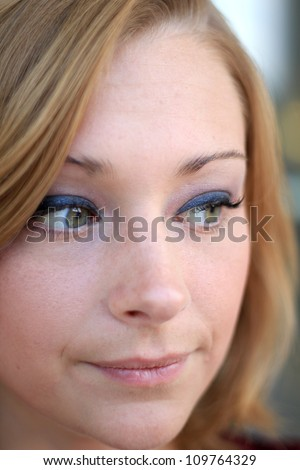 Attractive, Young Professional Business Woman Smiling and Looking To the Side - stock photo