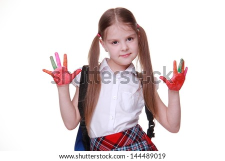 Attractive young schoolgirl wearing white blouse and red skirt cell with funny two tails and school bag - stock photo