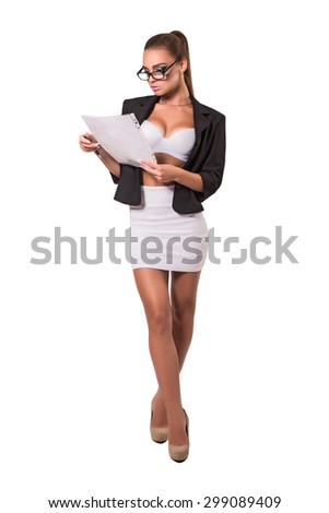 Attractive young serious business woman portrait - stock photo